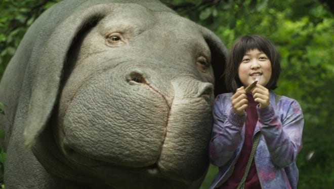 "Mija (An Seo Hyun) is determined to protect her genetically modified pet, Okja, in Bong Joon Ho's new movie ""Okja."""