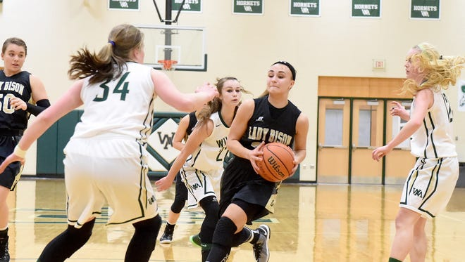 Buffalo Gap's Destiny Harper makes a run for the basket as Wilson Memorial's Leara Shumate guards during a basketball game played in Fishersville on Friday, Jan. 16, 2015.