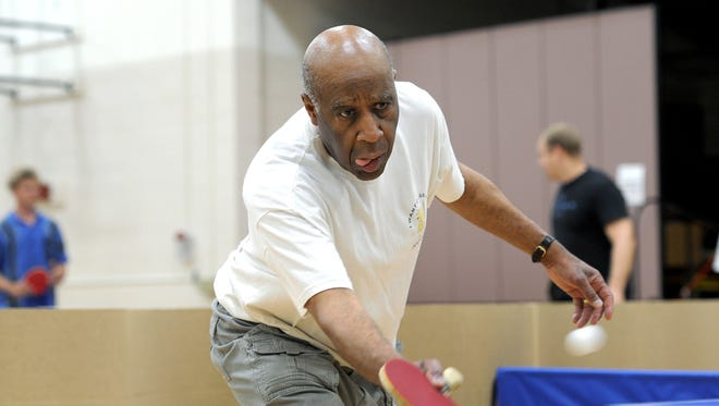 """Lee Morgan reaches to return the ball during an open play night with the Asheville Table Tennis Club at the Montford Recreation Center on Monday. """"I try to keep active and it's a great way to stay active,"""" he said."""