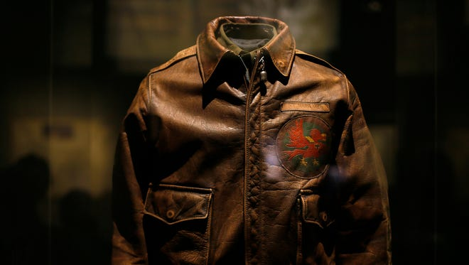 """A flight jacket worn by Lt. Donald E. Howard is displayed at the new """"Treasures of Our Military Past"""" exhibit at the Cincinnati Museum Center on Friday."""