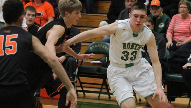 Oshkosh North junior Philip Flory will be out for the start of the season after breaking his foot. He led the Spartans last year, scoring 14.9 points per game, and is expected back around late December.