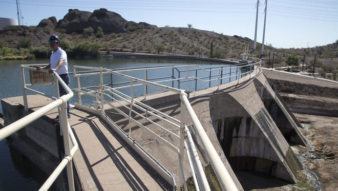 John Blevins, the SRP manager of hydro generation, stands on the Crosscut pond dam May 31, 2016, in Tempe.