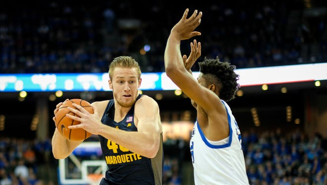 Marquette center Luke Fischer drives to the basket against Creighton's Justin Patton.