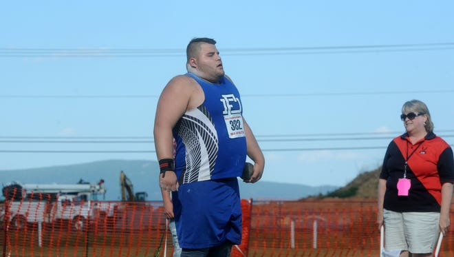 Fort Defiance's Zach Boyers gets prepared to throw during Friday's Group 3A state championship shot put at Harrisonburg High School.