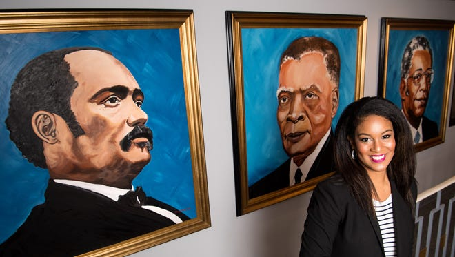 LaDonna Boyd, President/CEO and Chairman of the Board of R. H. Boyd Publishing Corporation, poses for a portrait next to paintings of Rev. Dr. Richard Henry Boyd, left, Dr. Henry Allen Boyd, center, and Dr. T. B. Boyd, Jr., right, at the company's facility in Nashville, Tenn., Wednesday, Nov. 1, 2017.