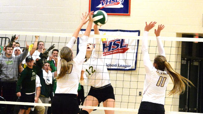 Wilson Memorial's Paris Hutchinson (12) finished with 14 kills on 28 attacks Saturday night as the Hornets beat Poquoson in the Class 2 state quarterfinals.