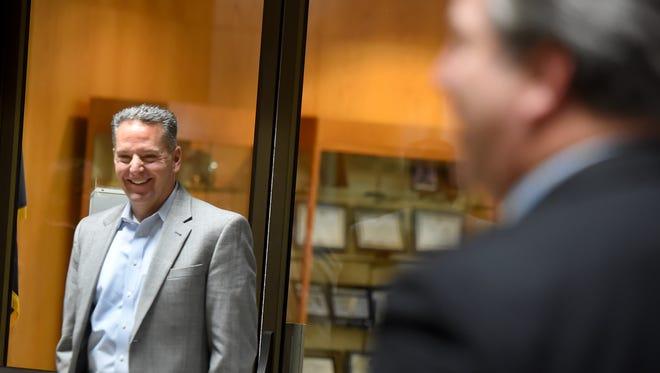 George Troyano, left, is named by Thomas Donovan, right, Northeast Regional President of Gannett East Group, as the interim president of the Gannett Pa. properties.