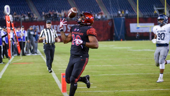 Rashaad Penny of San Diego State scores a touchdown in the first half.