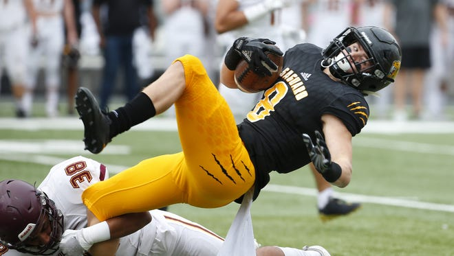 Salpointe Catholic Christian Vasquez (38) tackles Saguaro Connor Soelle (8) during the 4A high school football state championship game at Arizona Stadium in Tucson on December 1, 2017.