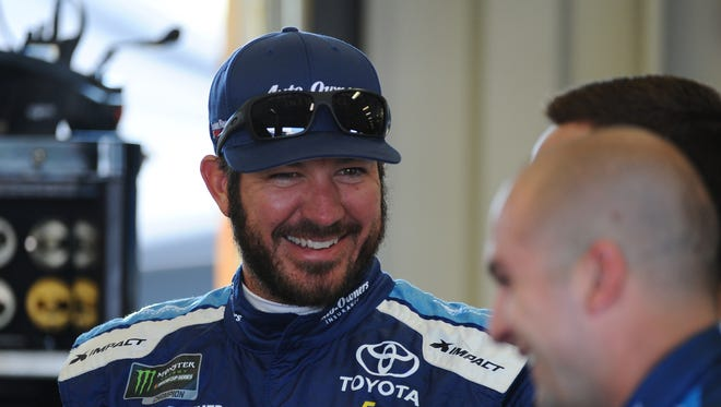 Martin Truex Jr. (78) in the garage before practice for the Quaker State 400 at Kentucky Speedway on July 13.
