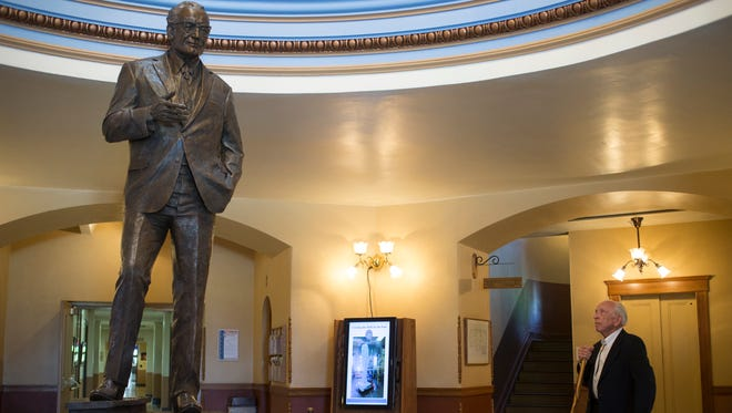 Former Phoenix Mayor John Driggs looks at the new Barry Goldwater statue on display at the State Capitol. Arizona's congressional delegation hopes it will be installed in National Statuary Hall in the U.S. Capitol by Feb. 14, Arizona Statehood Day.