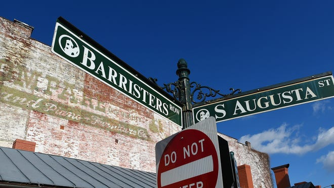 A sign marks Barristers Row as it runs behind the Augusta County Courthouse and connects with South Augusta Street in downtown Staunton. Photograph taken on Friday, Jan. 16, 2015.