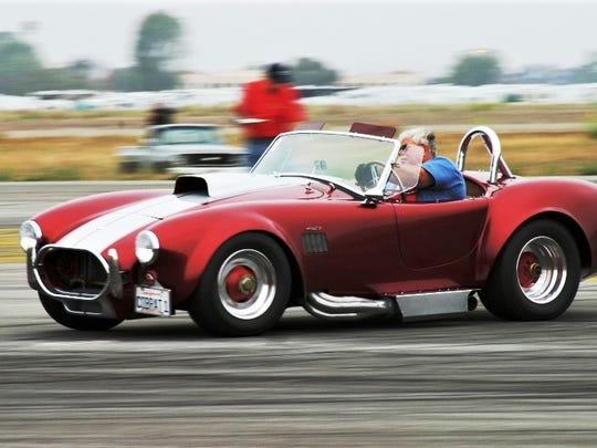 Dean Hornbacher behind the wheel of his replica Cobra,