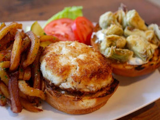 Crab cakes are half price on Fridays at Deep Blue Bar and Grill in Wilmington.