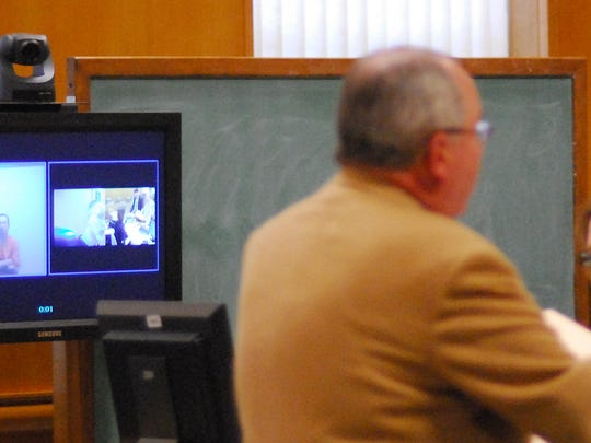 Joseph Reinwand of Wisconsin Rapids appears on video during his initial appearance in Wood County Court April 18, 2008.