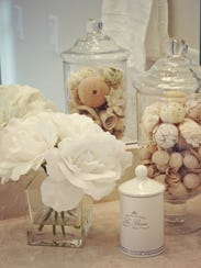 Artificial white flowers, a pretty small canister,