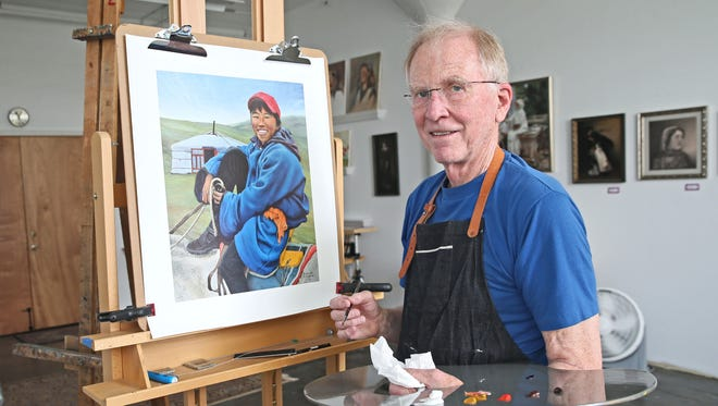 Michael McCabe of Glendale puts finishing touches on an oil on canvas painting in the Bay View studio space he shares with other painters. McCabe began painting in earnest when he retired seven years ago.