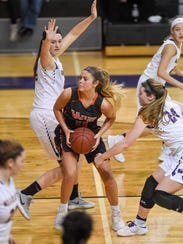 Valley's Shea Fuller (11) works her way to the basket