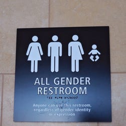 """An April 16, 2016, file photo shows an """"All Gender"""" bathroom sign at the San Diego International Airport."""