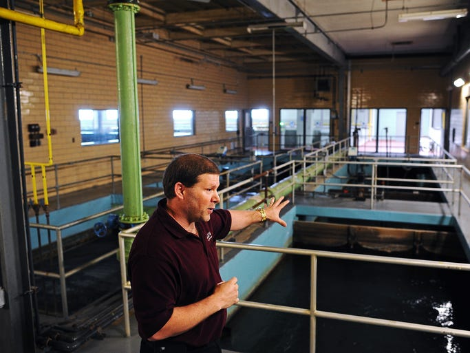 Darrin Freese, water program coordinator at the Water Purification Plant, gives a tour of the plant after a press conference about the city's water conservation efforts on Thursday, June 12, 2014, at the Water Purification Plant in Sioux Falls.
