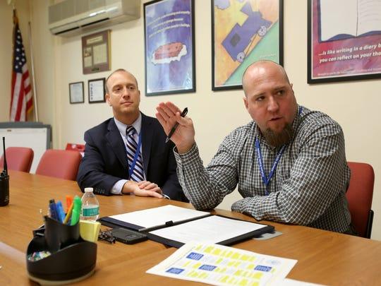 Pelham Middle School Principal Rob Roelle, left, looks on as IB Coordinator Sean Llewellyn talks.