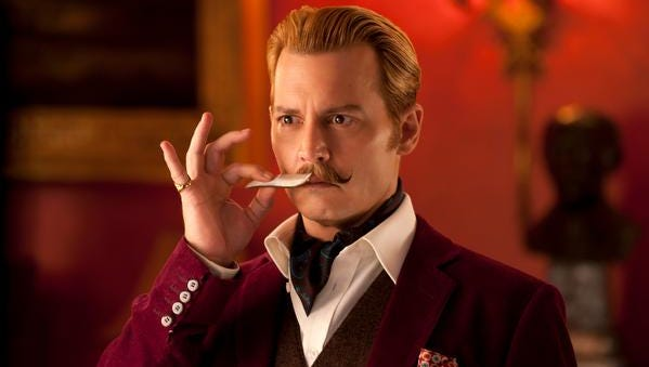 """Johnny Depp is Charlie Mortdecai -- and his mustache plays a large role, in the new movie  """"Mortdecai."""""""