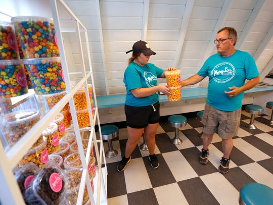 Owner Jeff Waldon and Sarah Woosley stack new snack