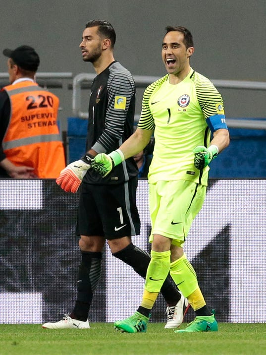 Chile goalkeeper Claudio Bravo celebrates next to Portugal goalkeeper Rui Patricio, center, after winning the Confederations Cup, semifinal soccer match between Portugal and Chile, at the Kazan Arena, Russia, Wednesday, June 28, 2017. (AP Photo/Ivan Sekretarev)