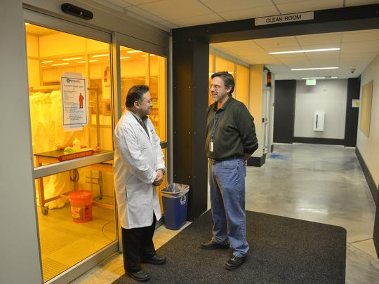Semaphore Scientific CEO Ned Tabat, left, talks with St. Cloud State University Associate Professor of Electrical Engineering Tim Vogt in December 2014 outside the clean room they use together at SCSU's ISELF building.