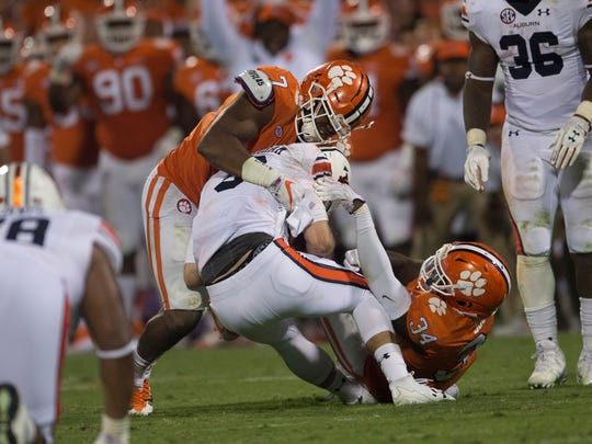 Clemson defensive end Austin Bryant (7) tackles Auburn quarterback Jarrett Stidham (8) during the NCAA football game between Auburn and Clemson on Saturday, Sept. 9, 2017, in Clemson N.C.