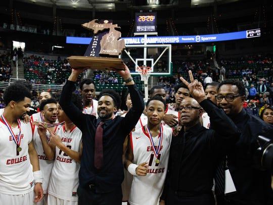 Detroit Edison PSA coach Brandon Boe Neely raises the