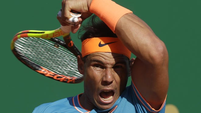FILE  - In this April 19, 2019, file photo, Spain's Rafael Nadal returns the ball to Argentina's Guido Pella during their quarterfinal match of the Monte Carlo Tennis Masters tournament in Monaco. Every other player in the men's bracket will be pursuing Nadal as the 34-year-old from Spain pursues history at the French Open that starts Sunday, Sept. 27, 2020.