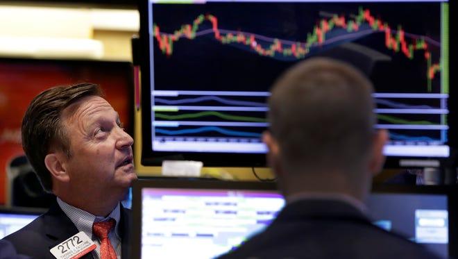 Specialists work on the floor of the New York Stock Exchange.
