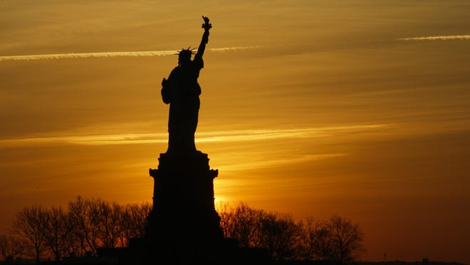 The Statue of Liberty is pictured from Liberty State Park on Jan. 21, 2018 in Jersey City, New Jersey. The iconic landmark was closed yesterday as part of the US government shutdown now entering its second full day after coming into effect at midnight on Friday after senators failed to pass a new federal spending bill.