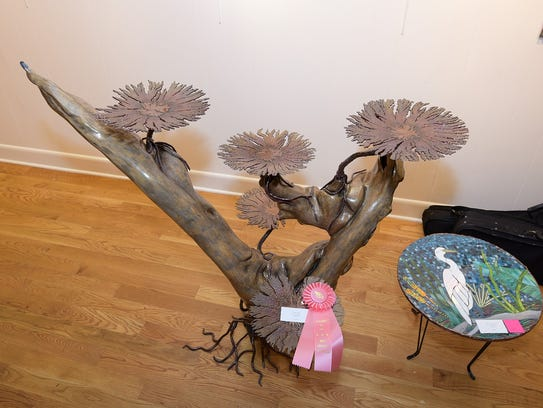 """Bruce Riley's """"Symbiosis"""" (left) received the award"""