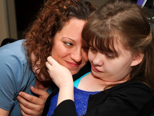 Private duty nurse Jessica Brown shares a tender moment