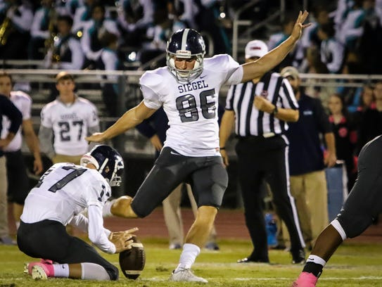 Siegel's Jacob Smith drills a 55-yard field goal during