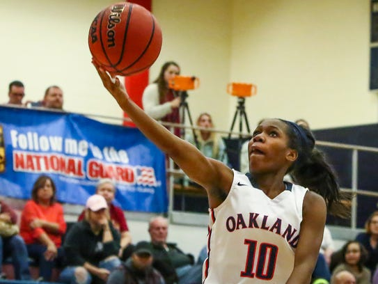 Oakland's Dakoria Puckett goes for a lay-in during