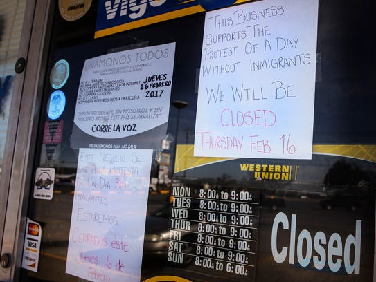 Signs on the door of Azteca Bakery in Smyrna tell customers