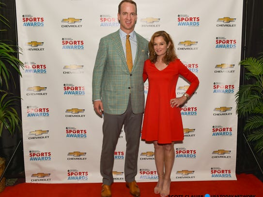 Peyton Manning poses for photos at The Advertisers