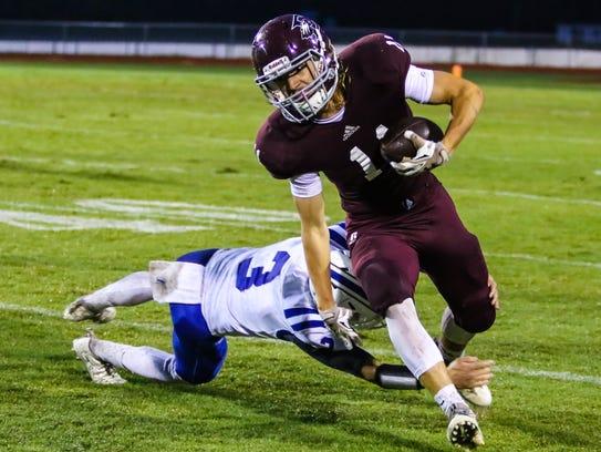 Eagleville senior receiver Graham Hatcher eludes a