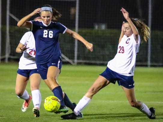 Oakland's Lainey Callis (right) and Siegel's Janie