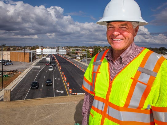 Former state Sen. Jim Tracy was among officials to take a tour of construction progress of the Bridge over Broad project.