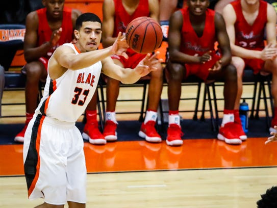 Blackman's Trent Gibson fires a pass during Tuesday's 66-39 win over Oakland. Gibson scored 10 points and had 12 assists in the win.