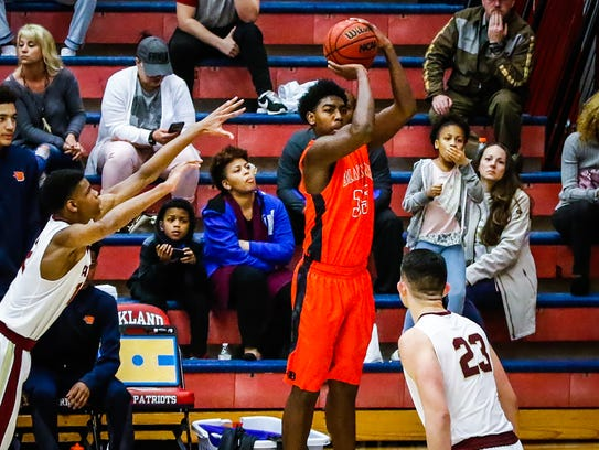 Blackman's Brandon Thomas hits a 3-pointer from the corner during Thursday's Region 4-AAA championship game, a 48-37 win over Riverdale.