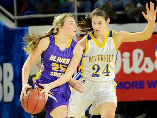 Riverside's Bree Linton guards Oliver Springs' Alivia