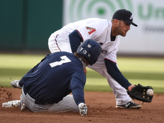 Aces shortstop Danny Worth catches the ball as Nevada's Cole Krzmarzick slide into second base after hitting a double against the Aces in the Tuesday's annual exhibition game at Aces Ballpark.
