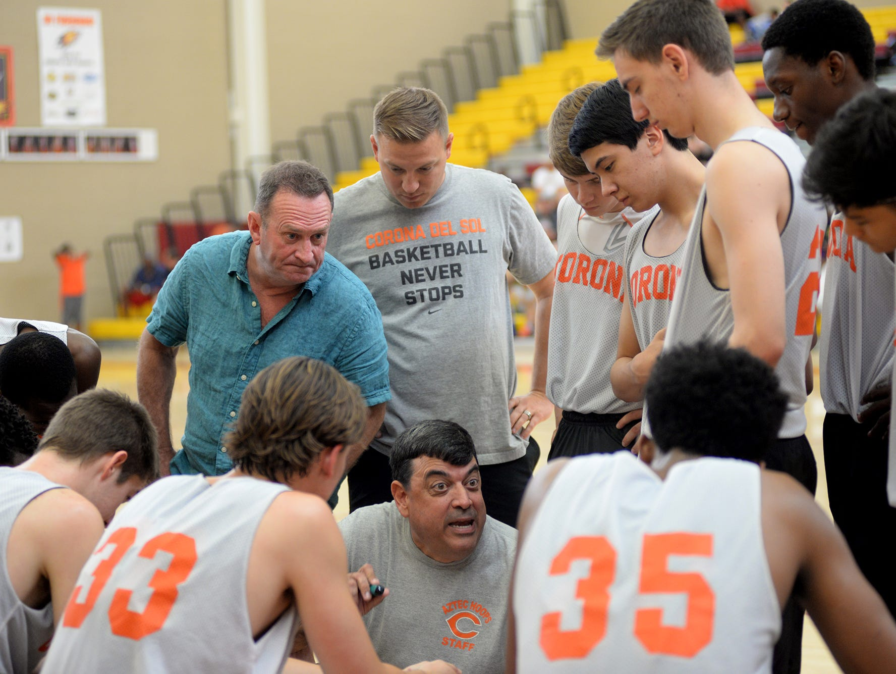 Corona Del Sol head coach Neil MacDonald speaks to his team during a game in June.