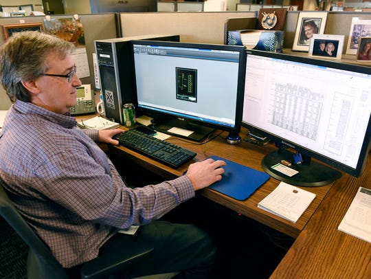 Ed Voigt, project drafter, works to design each granite