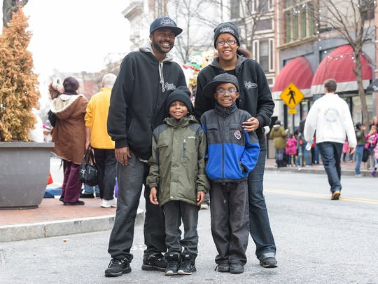 Albert Henry Sr., Benjimine Henry 8, Albert Henry Jr., 9, and Roslyn Henry of Wilmington pose for a photo at the end of the Wilmington Jaycees 52nd Annual Christmas Parade Saturday.